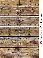 Old wooden gate background - Old wooden gate with wrought...