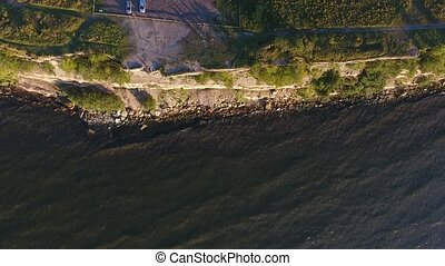 aerial view to cliff, baltic sea and bicyclists - travel,...