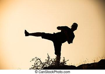 Silhouette taekwondo man at morning.