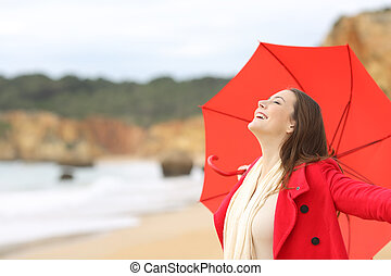 Joyful woman in red excited with umbrella - Joyful woman...