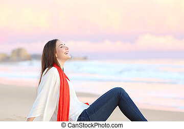Woman breathing fresh air at sunset - Side view of a happy...
