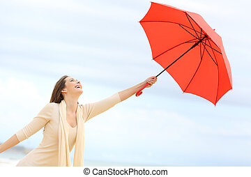 Playful girl joking with umbrella - Playful girl joking with...