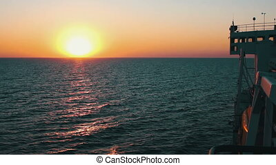 Big Cargo Ferry and Sunset on the Sea Sunset on the Sea with...