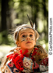 beautiful little girl playing outdoors in Indian...