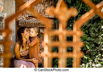 mother and daughter embrace,emotions on the background of...