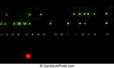 Network server switch LED blink in dark room Green and red...