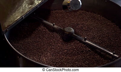 Coffee Roaster working - Freshly roasted coffee beans mixing...