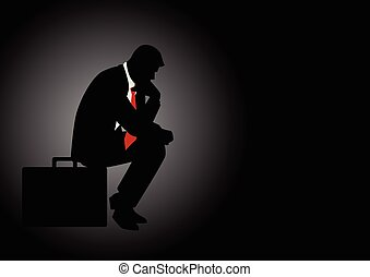 Pensive businessman sitting on his briefcase - Silhouette...
