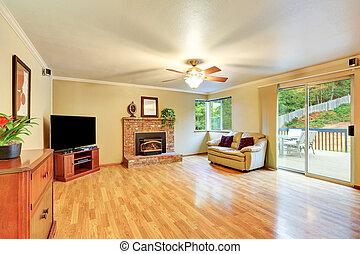 Cozy hardwood living room with glass door exit to the deck