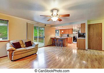 Cozy hardwood living room with open floor plan
