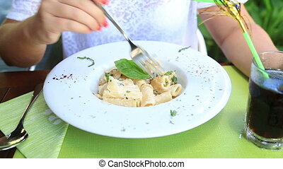 Eating pasta close up