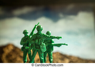 Toy Soldiers War - Green toy soldiers with mountaintops the...