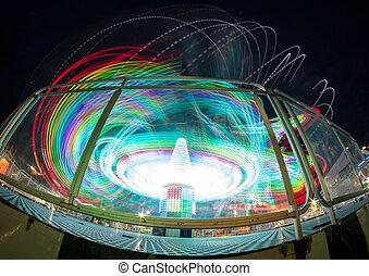 Amusement Park Light Blurs - Amusement park ride long...