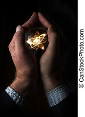 Crystal Ball Atom - Holding atom in fortune teller magic...