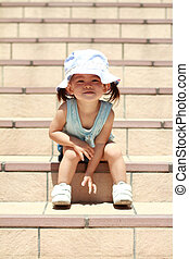 Japanese girl sitting on the stairs 1 year old