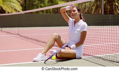 Female Tennis Player Taking a Break on Hot Court - Full...