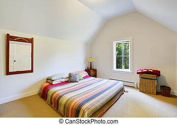 Simple design of attic bedroom with vaulted ceiling