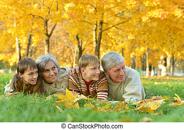 Grandparents with children in park