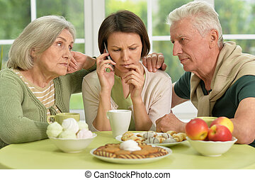 Senior parents with worried daughter