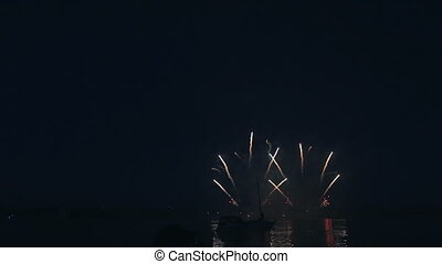 Beautiful fireworks under the river on background of black...