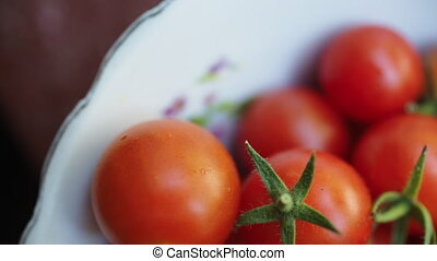 Tomatoes are on the plate - Fresh juicy ripe tomatoes are on...
