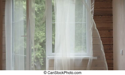 Curtain blowing in the breeze