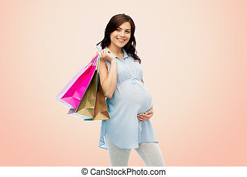 happy pregnant woman with shopping bags - pregnancy, sale,...