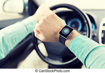 hands with starter icon on smartwatch driving car -...