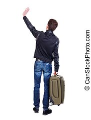 Back view man with green suitcase greeting waving - Back...