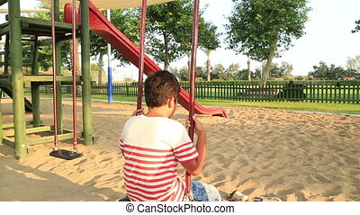 Lonely child boring at the playground - Lonely, sad boy at...