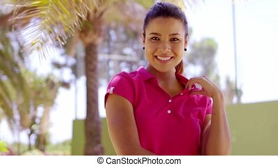 Beautiful woman in pink blouse near palm tree - Single...