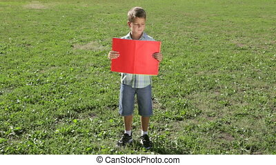 Smiling boy standing with empty blank banner - Smiling boy...