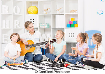 School music group at their weekly rehearsal - Group of...