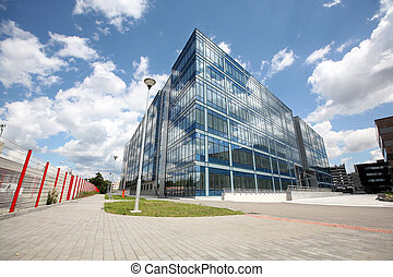 New modern futuristic building and blue skyes in cloudy day