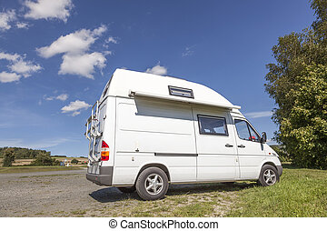 White camper van on a camping site
