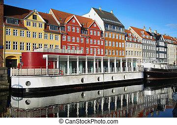 Nyhavn new Harbor in Copenhagen, Denmark - Yacht and color...
