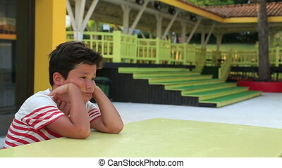 Lonely child boring - Boring cute schoolboy sitting at the...
