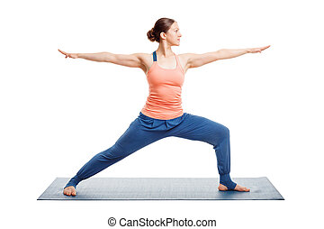 Sporty fit yogini woman practices yoga asana utthita...