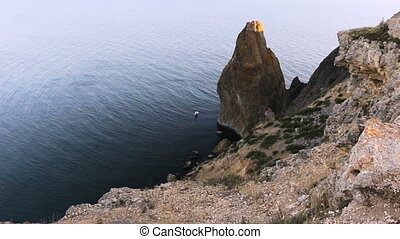 The Crimean seascape with height - Rocky cape on seacoast....