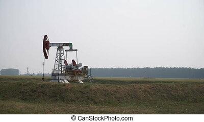 Oil rig in a cornfield
