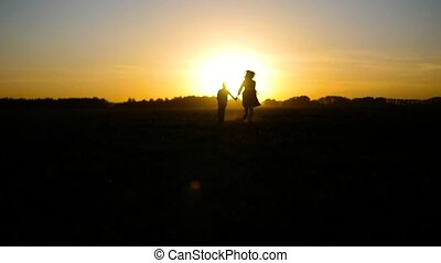the boy with the girl running into the sunset