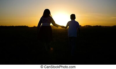 the boy with the girl running away into the sunset