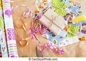 lot of stuff for handmade gifts, scissors, ribbon, paper with countryside pattern, ready for holiday concept, nobody home