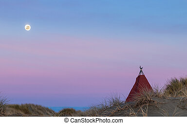 Tepee Moonlight - Tepee on a beach sand dune, with a bright...