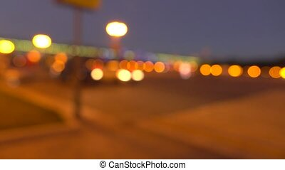Blurred evening street. Lights and cars. 4K background bokeh...