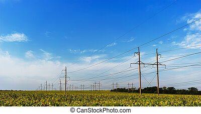 standard overhead power line transmission tower on a sky...