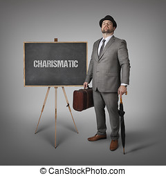 Charismatic text on blackboard with businessman -...