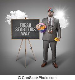 Fresh start this way text with holiday gear businessman and...
