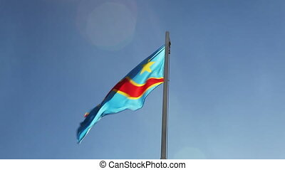 National flag of Democratic Republic of Congo on a flagpole
