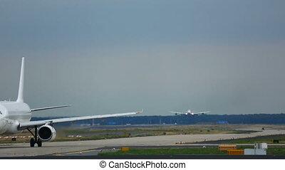 Traffic at Frankfurt airport - Airplane waiting at executive...